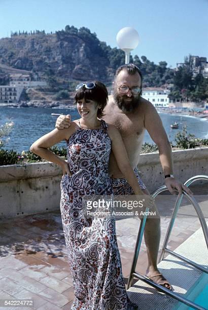 Italian actor Sergio Leone with his wife Carla in a swimming pool 1972