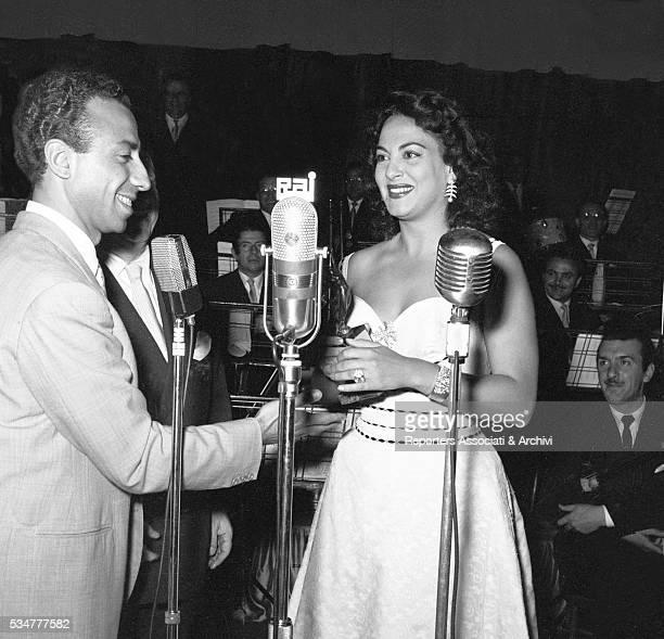 Italian actor Silvio Noto awarding Greekborn Italian actress Yvonne Sanson with the Vittorie cinematografiche award Rome 10th June 1954