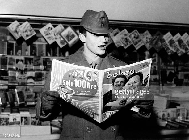 Italian actor singer and songwriter Tony Renis reading the Bolero magazine The singer and songwriter takes part in the Sanremo Music Festival with...