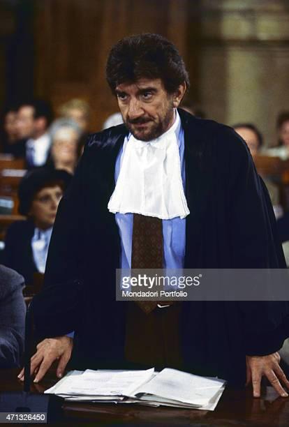 Italian actor, singer, director and dubber Gigi Proietti playing a lawyer in the TV series L'avvocato Porta. Rome, 1997