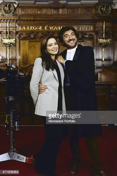 Italian actor singer director and dubber Gigi Proietti posing with Italian actress Ornella Muti on the set of the TV series L'avvocato Porta Rome 1997