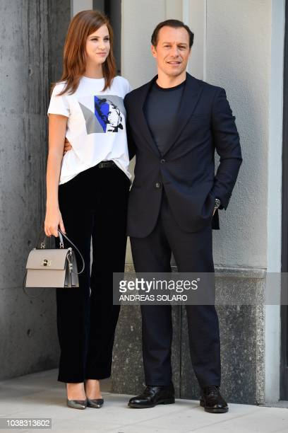 Italian actor Stefano Accorsi and his wife Italian actress Bianca Vitali posefor photographers after attending the Armani fashion show as part of the...