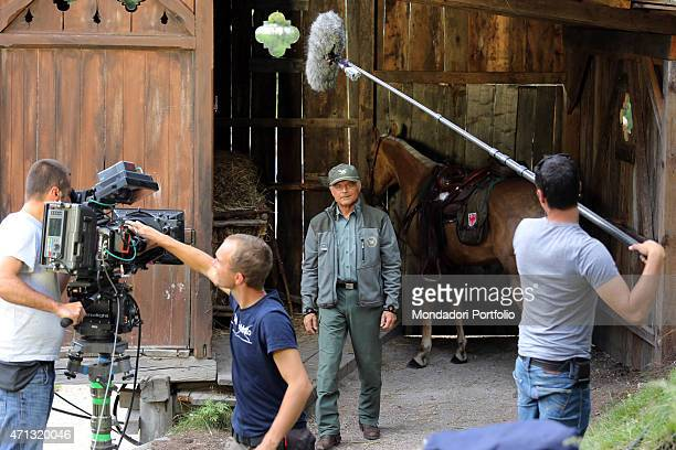 Italian actor Terence Hill as the State Forestry Corps Chief inspector Pietro coming out of a horse stable while shooting on the set the TV series...