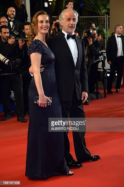 """Italian actor Toni Servillo and his wife actress Manuela Lamanna pose on May 21, 2013 as they arrive for the screening of the film """"La Grande..."""