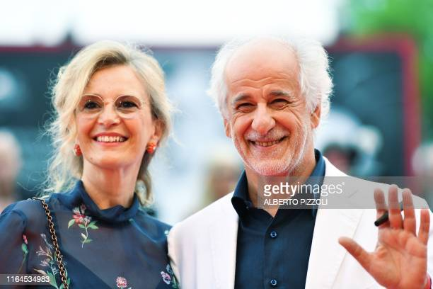 Italian actor Toni Servillo and his wife Italian actress Manuela Lamanna pose as they arrive for the opening ceremony and the screening of the film...