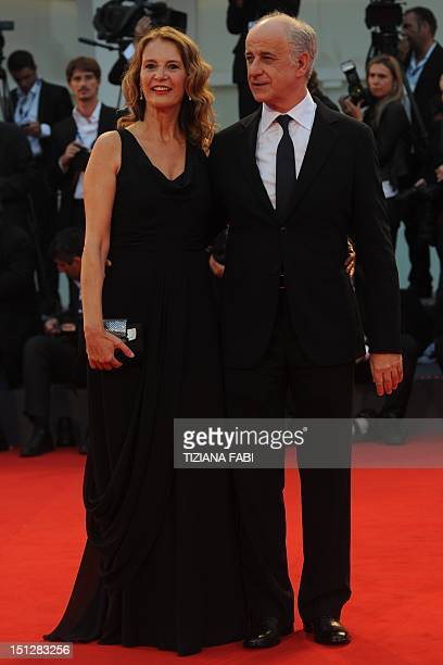 """Italian actor Toni Servillo and his wife Manuela Lamanna arrive for the screening of """"Bella addormentata"""" during the 69th Venice Film Festival on..."""