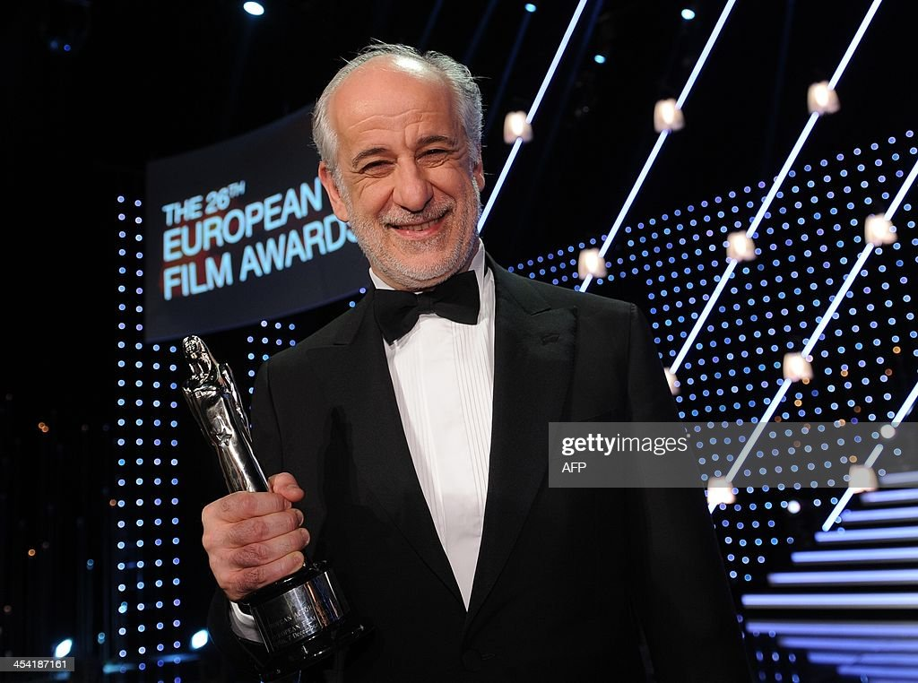 Italian actor Toni Servillo poses with his award at the 26th European Film Awards ceremony on December 7, 2013 in Berlin. Every year, the various activities of the European Film Academy culminate in the ceremony of the European Film Awards. In a total of 21 categories, among them European Film, European Director, European Actress and European Actor, the European Film Awards annually honour the greatest achievements in European cinema.
