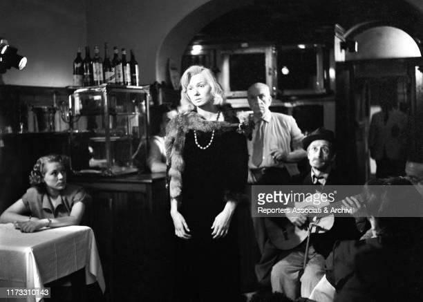 Italian actor Totò accompanying on the guitar Italian actress Olga Villi in the film Yvonne the Night 1949