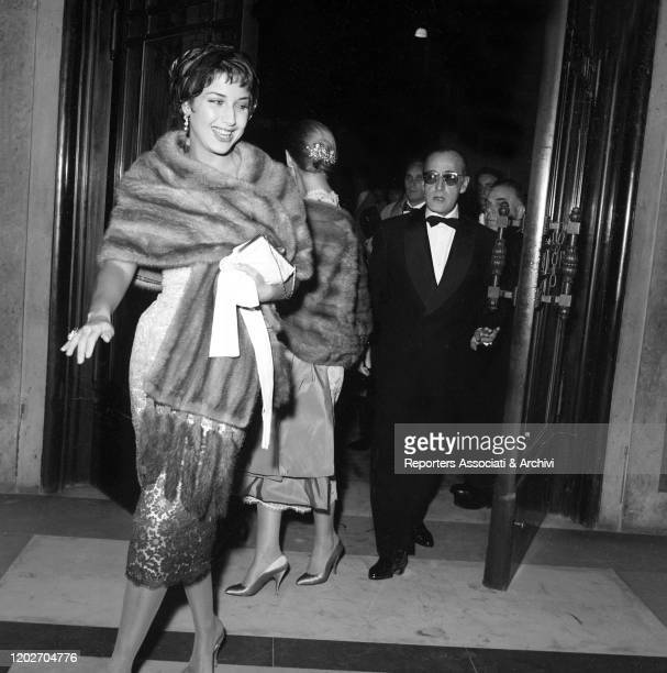 Italian actor Totò and his partner and Italian actress Franca Faldini attending the gala for the premiere of the film War and Peace at the Opera...