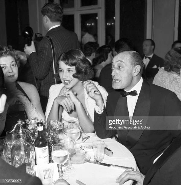 Italian actor Totò and his partner and Italian actress Franca Faldini sitting at the table at the Gran Galà del Cinema at the Grand Hotel. Rome, 19th...