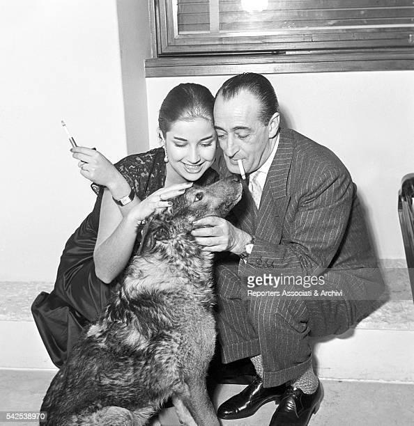 Italian actor Totò and his wife, Italian actress Franca Faldini. Stroking a dog. Rome, 1955