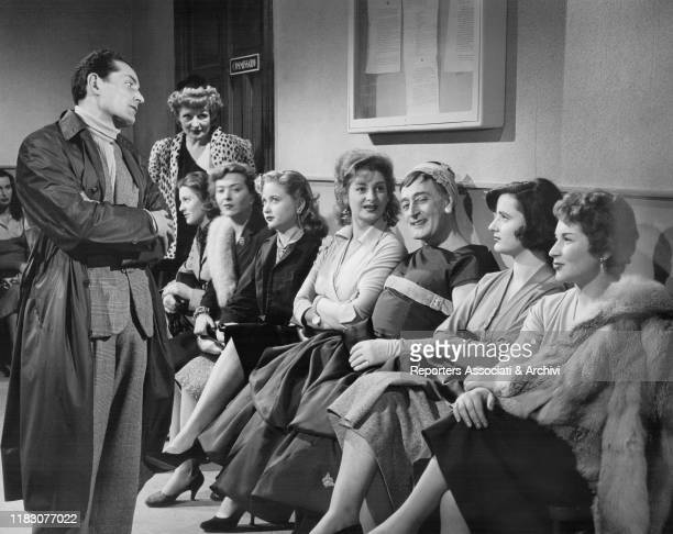 Italian actor Totò dressed as a woman in the film Are We Men or Corporals 1955