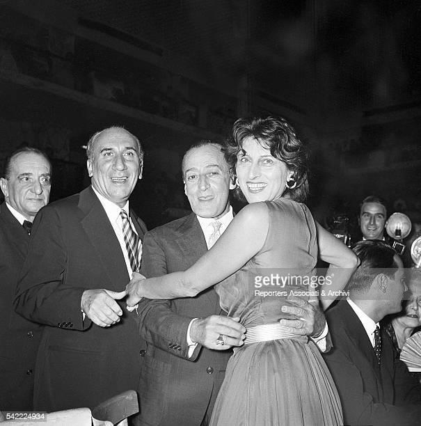 Italian actor Totò joking with Italian actress Anna Magnani at the Silver Ribbon award ceremony in Villa dei Cesari Rome 18th July 1956
