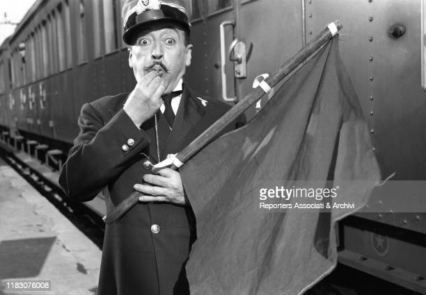 Italian actor Totò playing the station master in the film Destination Piovarolo 1955