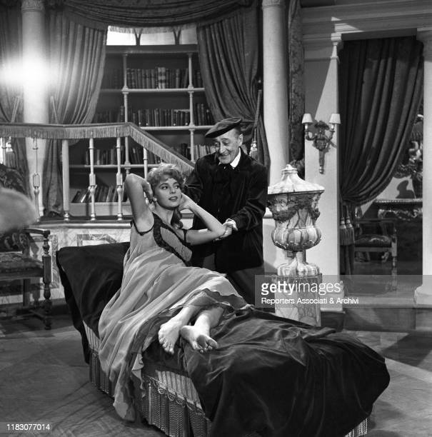 Italian actor Totò smiling at American actress and singer Abbe Lane in the film Toto in Madrid. 1959