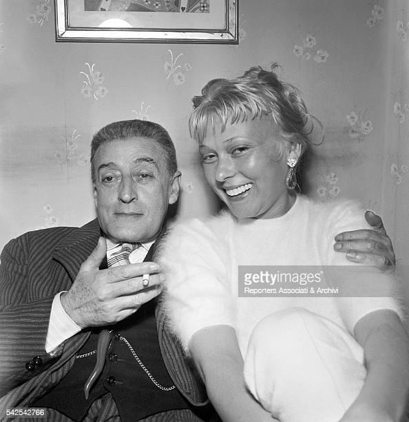 Italian actor Totò smoking with Italian actress Dorian Gray on the set of Totò Peppino e la malafemmina 1956