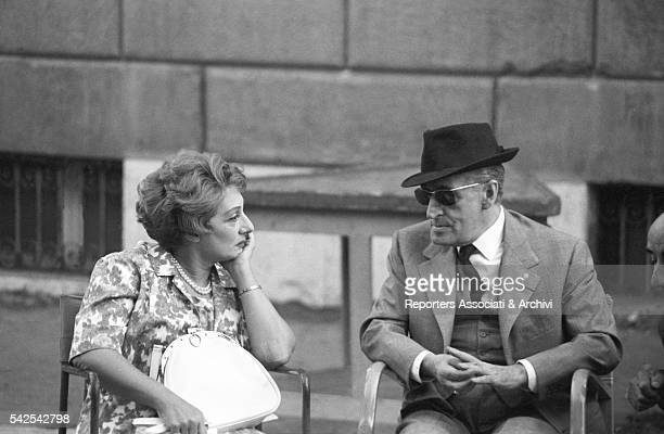 Italian actor Totò talking to Italian actress Andreina Pagnani during a break on the set of Il comandante Rome 1963