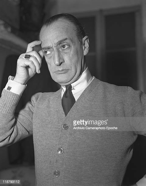 Italian actor Toto' Antonio De Curtis wearing a cardigan a tie and a ring portrayed making a thoughtful expression 1950