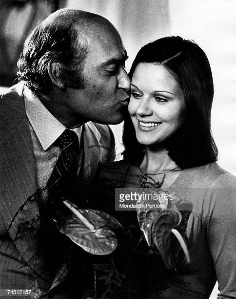 Italian actor Turi Ferro kissing Italian actress Agostina Belli in The Governess Rome 1974