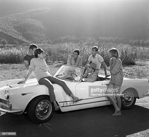 Italian actor Ugo Tognazzi driving an Alfa Romeo with French actress Catherine Spaak in Crazy Desire Italy 1962