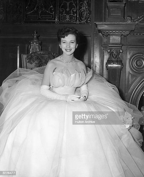 Italian actor Valentina Cortese wearing a strapless tulle ball gown and a jeweled necklace smiles in a promotional photo for director Robert Wise's...