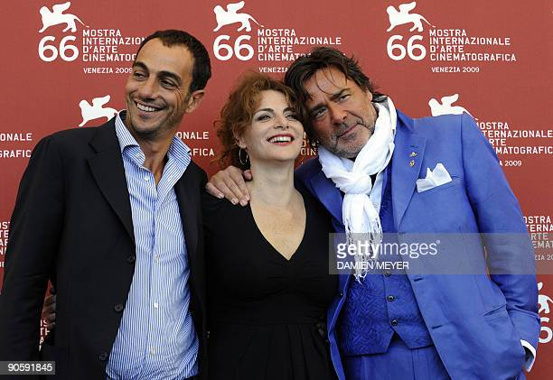 "Italian actor Vincenzo Varzi, actress Caterina Varzi and actor Alberto Petrolini pose during the photocall of ""Hotel Courbet"" at the Venice film..."