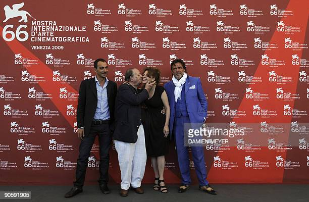 "Italian actor Vincenzo Varzi, director Tinto Brass, actress Caterina Varzi and actor Alberto Petrolini pose during the photocall of ""Hotel Courbet""..."