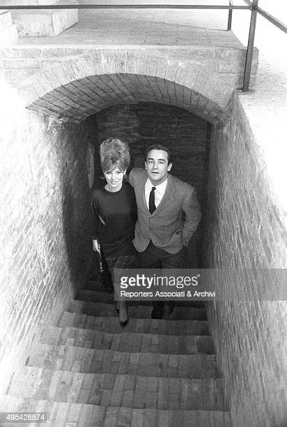 Italian actor Vittorio Gassman and Danish actress Annette Stroyberg climbing the stairs at Verona Arena while shooting the film Barabbas Verona 1961