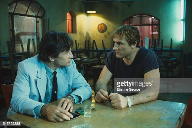 Italian actor Vittorio Mezzogiorno and French actor Gerard Depardieu on the set of the film La Lune Dans le Caniveau , directed by French director...