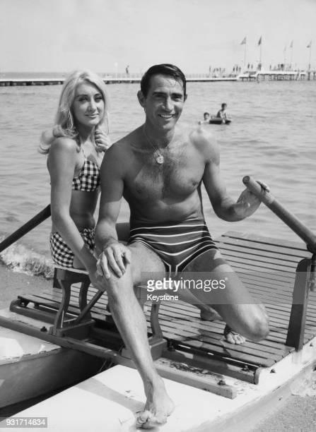 Italian actor Walter Chiari and American actress Linda Gaye Scott on the beach in Venice Italy during the Venice Film Festival circa 1965