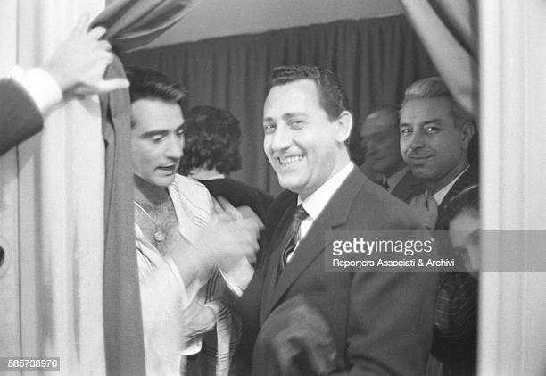 Italian actor Walter Chiari being praised by the actor Alberto Sordi in the dressing room after the theatre show performed by his acting company Rome...
