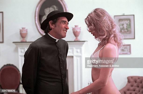 Italian actor Walter Chiari dressed as a priest and Italian actress Anna Maria Rizzoli in the film Ride bene chi ride ultimo segment Prete per forza...