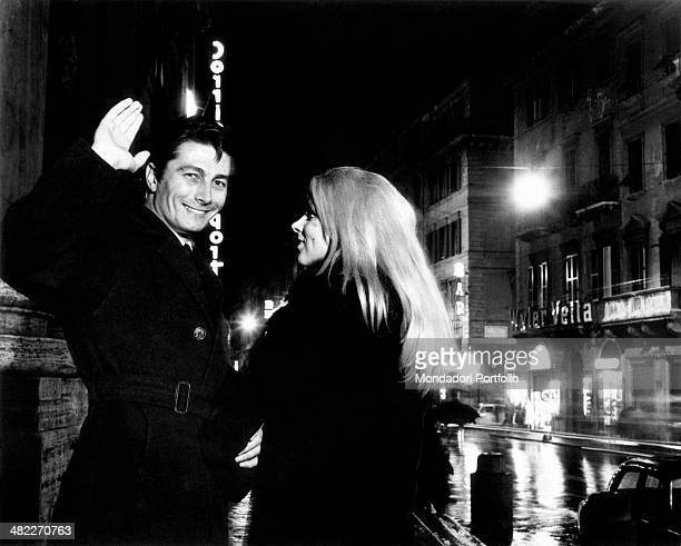 Italian actor Warner Bentivegna greeting someone in a street of the Italian capital city beside a friend. Rome, 1963