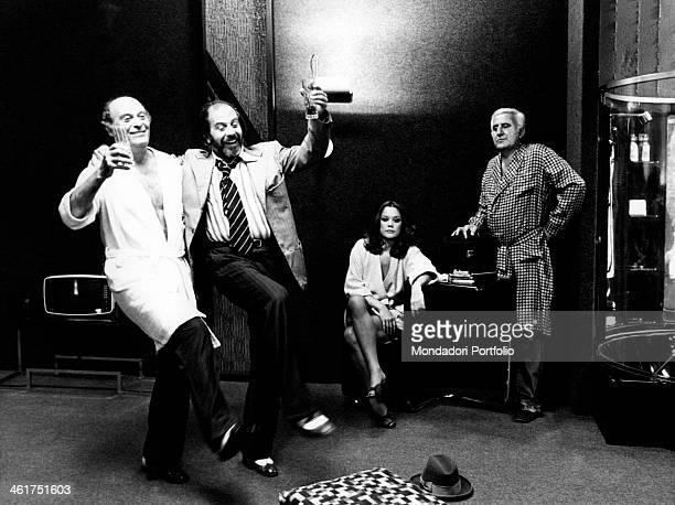 Italian actors Adolfo Celi and Valeria Moriconi looking at Italian actors Enrico Maria Salerno and Turi Ferro dancing in the film Che notte quella...