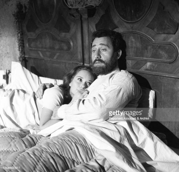 Italian actors Alberto Sordi and Lea Massari hugging each other in the bed in the film A Difficult Life. Italy, 1961
