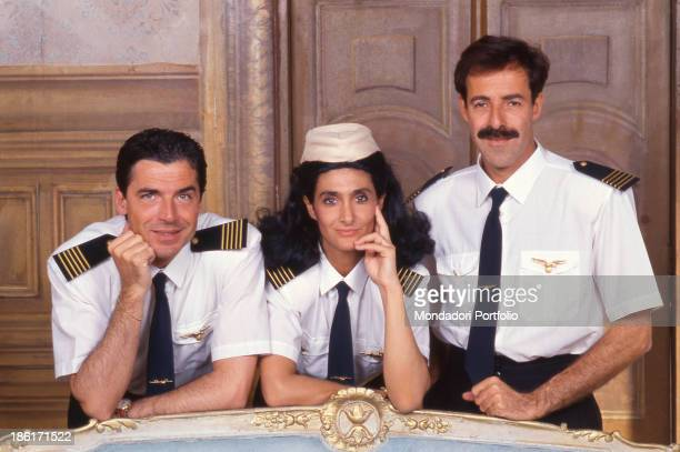 Italian actors and comedians Massimo Lopez, Tullio Solenghi and Anna Marchesini dresses as three airline pilots in the theatrical show Allacciare le...