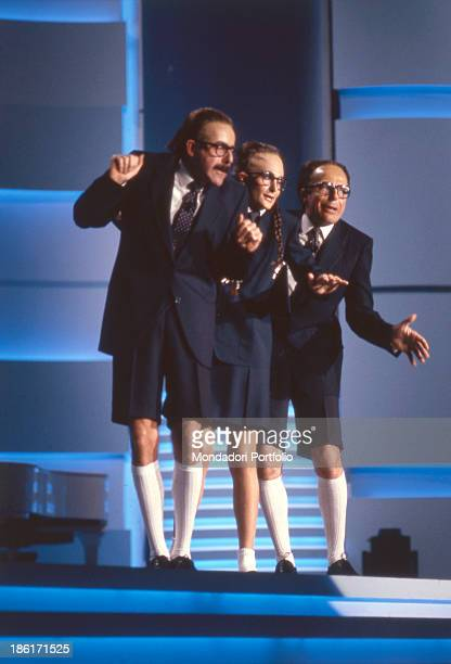 Italian actors and comedians Massimo Lopez Tullio Solenghi and Anna Marchesini dancing and singing at 39th Sanremo Music Festival The Trio parody...