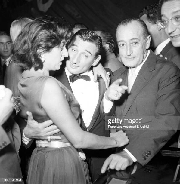 Italian actors Anna Magnani and Totò and Italian actor and singersongwriter Renato Rascel joking at the Maschere d'Argento awarding ceremony in EUR...