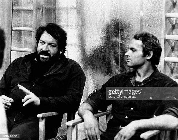 Italian actors Bud Spencer and Terence Hill sitting on two chairs on the set of the film Watch Out We're Mad Rome 1974