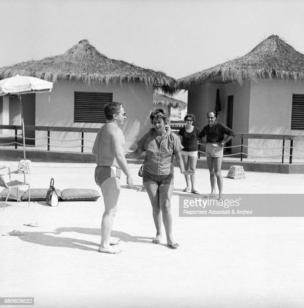 Italian actors Carlo Croccolo and Alida Valli dancing in the beach resort Calypso Torvaianica 1962