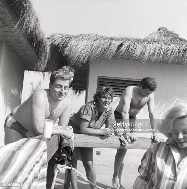 Italian actors Carlo Croccolo and Alida Valli in the beach resort Calypso Torvaianica 1962