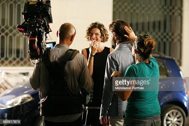Italian actors Chiara Ricci and Sergio Assisi in a street with a cameraman and a makeup artist during a photo shoot realized on the set of 'Una...
