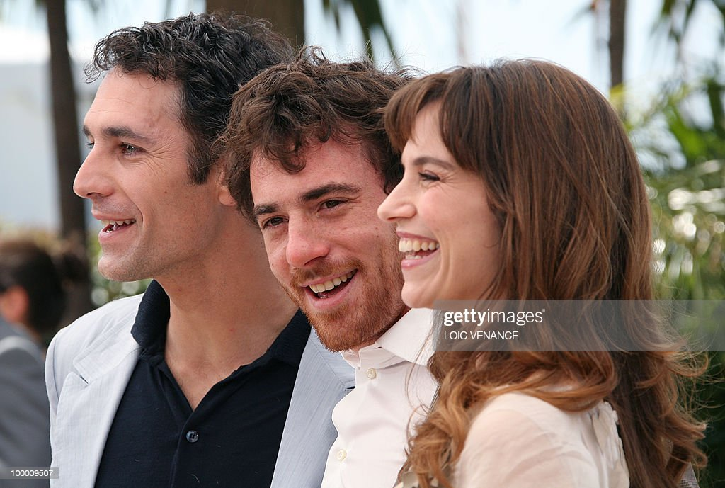 Italian actors Elio Germano (C), Stefania Montorsi and Raoul Bova pose during the photocall of 'La Nostra Vita' (Our Life) presented in competition at the 63rd Cannes Film Festival on May 20, 2010 in Cannes.