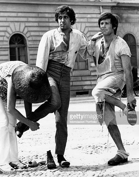 Italian actors Enzo Cerusico and Adriano Celentano on the set of the movie The Five Days of Milan they prepare themselves to shoot a scene wearing...