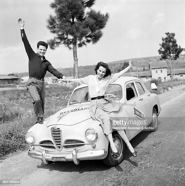Italian actors Franco Interlenghi and Antonella Lualdi posing on their Alfa Romeo 1900 Italy 21st April 1955