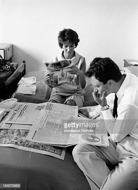Italian actors Franco Interlenghi and Antonella Lualdi reading the newspaper in their bedroom Venice 26th August 1958