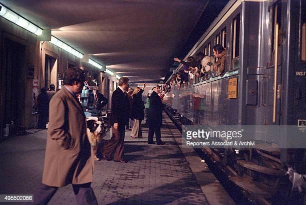 Italian actors Gastone Moschin Ugo Tognazzi and Adolfo Celi standing on the platform of Santa MAria Novella railway station and waiting for the train...