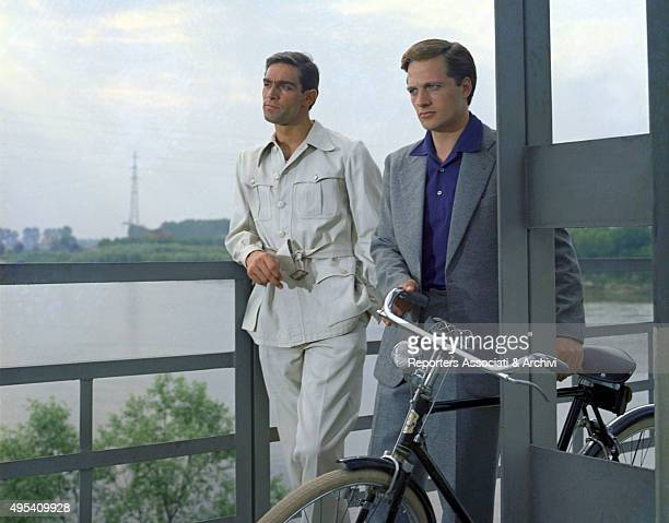 Italian actors Lino Capolicchio and Fabio Testi thoughtful and looking far in a scene from the film The Garden of the Finzi-Continis. Italy, 1970