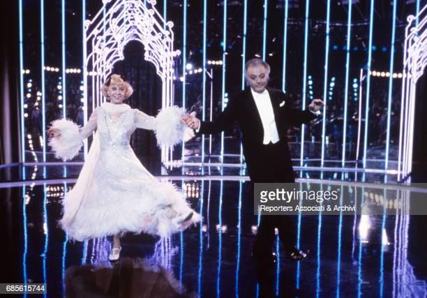 Italian actors Marcello Mastroianni and Giulietta Masina dancing in Ginger and Fred 1985