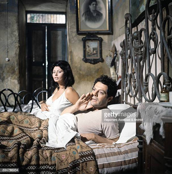 Italian actors Marcello Mastroianni and Sophia Loren lying in bed in the film Yesterday Today and Tomorrow segment Adelina 1963